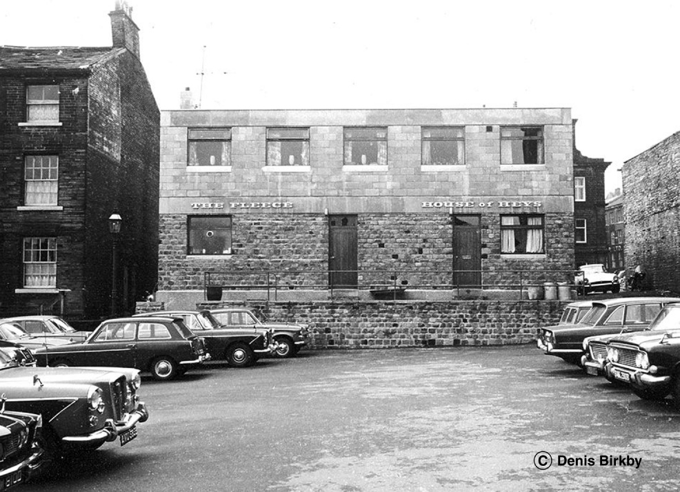 View from the car park of the Fleece Inn. By the early 1980s the house had been re-named Le Nouveau. Webster's Yorkshire Bitter and Best was on sale then from hand pumps. Glass was added to the terrace at the front making it look like a greenhouse. Possibly readers might recall when the pub closed. A block of apartments now stands on the site.